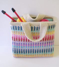 Free Knitting Pattern for Scrap Bag - This tote is knit in slip stitch colorwork with short lengths of scrap yarn of different colors so it's the perfect stash buster for small amounts of yarn. Insertplastic canvas in the front back and base to give it sturdiness.The finished bag is 28 cm wide, 27 cm tall and 8 cm deep. Designed by Frankie Brown.
