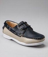 This shoe has the class of a 40-foot yacht and features contrast stitching and a sleek silhouette. A quick sailors' knot will anchor this pair in place and the thick traction sole is perfect for walking around, even with sea legs. When an ocean cruise isn't on the schedule for the day, these shoes look great with slacks. Man-made upper