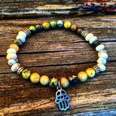 Hamsa charm bracelet by FeathernStoneJewelry on Etsy