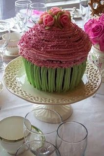 Giant Cupcake Wedding cakes    i like this idea not this particular cupcake