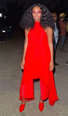 Solange Knowles in a bold red ensemble.