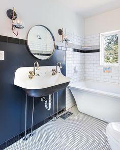Nice clean bathroom remodel with our #orbitsconce (via @buildwell_builders) #schoolhouseelectric