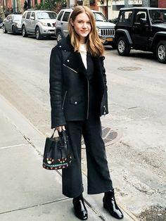 """On style director Nicole Kliest: Veda jacket and jumpsuit; Tory Burch shirt; Les Petit Joueurs Daliah Bucket Bag($950); vintage boots. """"In search for warmth and a quick bite after Jason Wu!"""""""