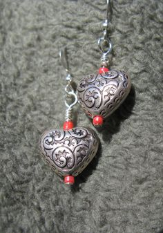 Just in time for Valentines Day! Lovely metallic scrollwork design hearts, accented with red beads. Act fast, only one pair available! Free