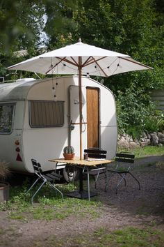 Simple sweet serene - white vintage caravan with white umbrella | tiny trailer - camper