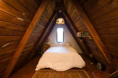 Tucked away in the Redwood trees of Cazadero, California stands this unassuming A-frame cabin. It appears tiny on the outside, but the interior tells a different tale. While one of the original aims of A-frame construction is to easily shed snow—we've previously seen what can go wrong when too much