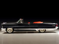 1956 Lincoln Premiere convertible...sure is a lot more tasteful than its' Cadillac counterpart for the year...!