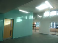 Rodborough NAS Cullum Centre, UK. The central hub space of this ASD 'integration centre' allowing high performing pupils with ASD to access mainstream secondary education.. Mark Ellerby Architects.