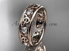 14kt rose gold celtic trinity knot wedding band, engagement ring CT7160B It has 7 genuine white saphires total weight of . 50ct. The width of the ring is 6.0mm and the thickness is 2.2mm. All sizes ar