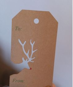 Reindeer cutout on this Kraft tag is so awesome, and the red nose is the perfect… – Christmas DIY Holiday Cards Noel Christmas, Winter Christmas, All Things Christmas, Reindeer Christmas, Christmas Tree Stencil, Diy Christmas Tags, Christmas Gift Wrapping, Christmas Present Tags, Holiday Gift Tags