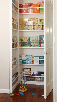 I really loove this idea.... In an already small room shared by 2 boys - this wasted space behind the door always bugs me, great way of making use of all available space!