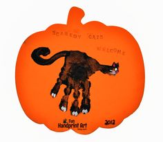 Make a simple 'Scaredy Cats Welcome' Halloween sign using a handprint to make a black cat! Kids will love helping decorate for Halloween with their craft!