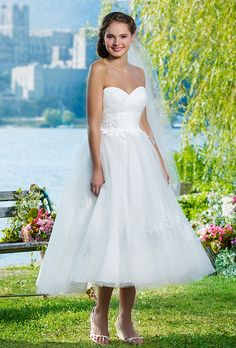Brides: Sweetheart Gowns. Tulle ball gown featuring a sweetheart neckline.