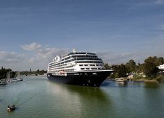 Cruise arriving to the port of Seville, Spain, an ancient city with almost 3000 years of history