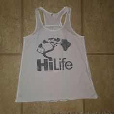 Hawaii life tank top! Hi life or as we call it - Hawaii life! #luckywelivehi Cute local tank top from Hawaii. Size large (I thought I could pull.it off but ita just too big on me!) Would fit medium or large . White with grey silver tree of life .  <3 Brandy Melville Tops Tank Tops