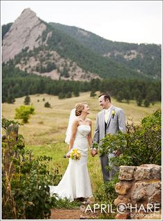 "Just one peak of the flatirons peeking through in this ""First Look"" photo at Chautauqua Park in Boulder.  - April O'Hare Photography #Boulder #BoulderWedding #Chautauqua #ChautauquaWedding #Colorado #ColoradoWedding #FirstLook #ColoradoWeddingPhotographer"
