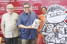 Cartoonist Lat (centre) seen here at the launch of his biography 'Lat: My Life and Cartoons' immortalised his teacher Mrs Hew in his comic 'Kampung Boy.' — Picture by Tunku Zain Al-'Abidin