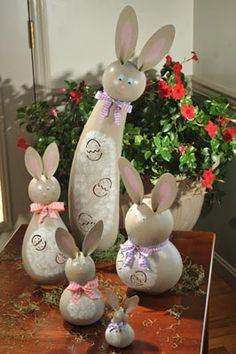Our Kourtney Collection is made up of grey bunny gourds with white bellies and brightly colored bows.