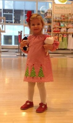 CHRISTMAS!  Our 2014 Christmas dress is the cutest yet! Order now while we have plenty of fabric.