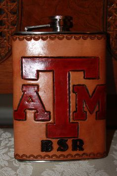 Texas A&M 8 oz Hand Tooled Custom Leather Wrapped Stainless Steel Flask or any Big 12 or SEC School would be a great gift to your Aggie groomsmen on your wedding day!  Follow thehowdyweddingguide on Instagran for more Aggie wedding shares!