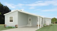 The TNR Model manufactured home features 2 bedrooms, 2 baths and spacious living and dining area. See more features of this mobile home and request info here. Exterior Wall Design, Best Exterior Paint, Exterior Rendering, Exterior Paint Colors For House, Brick Design, 2 Bedroom Floor Plans, Mobile Home Floor Plans, House Floor Plans, Manufactured Homes Floor Plans
