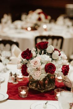 Stunning low flower arrangement with red, white and pink roses complimented by a red table runner Pink And White Wedding Themes, White Wedding Decorations, White And Pink Roses, White Roses Wedding, Quince Decorations, Red Wedding Flowers, White Rose Centerpieces, Wedding Centerpieces, Pink Wedding Receptions
