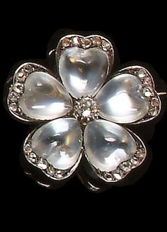A late Victorian moonstone and diamond flower brooch, circa Each petal set with a heart-shaped cabochon moonstone and edged with a row of rose-cut diamonds, a claw mounted single old brilliant-cut diamond to the centre, diameter later pin fitting Victorian Jewelry, Antique Jewelry, Vintage Jewelry, Moonstone Jewelry, Gemstone Jewelry, Jewelry Accessories, Jewelry Design, Antique Brooches, Fantasy Jewelry