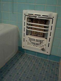 Vintage bathroom tile and heater -- These were in my childhood homes, for sure.