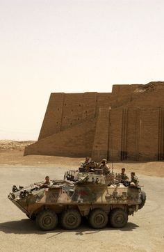 An Australian Army ASLAV armoured vehicle in front of the Great Ziggurat of Ur, Iraq 2005