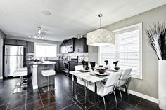 A quality home builder with 35 years of experience through our parent company Shane Homes. Visit our new communities, showhomes, new homes, quick possession homes and more. Room Kitchen, Dining Room, New Community, Home Builders, New Homes, Table, Furniture, Home Decor, Decoration Home