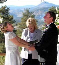 Denver wedding officiant Vicky Hampton laughing it up with her couple at Chief Hosa Lodge in Genesee, CO