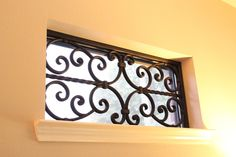 Decorative Faux Wrought Iron window insert by BMD Woodworks.