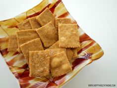 Easy Homemade Wheat Thin Crackers    Adapted from King Arthur Flour Whole Grain Baking Cookbook    Delicious homemade crackers that taste like the popular boxed variety, but are much healthier!    1 1/4 cup white whole wheat flour    1 1/2 tablespoons Sucanat or organic sugar*    1/2 teaspoon salt+ more for sprinkling on top    1/4 teaspoon paprika    4 tablespoons Earth Balance vegan butter**    1/4 cup water    1/4 teaspoon vanilla extract