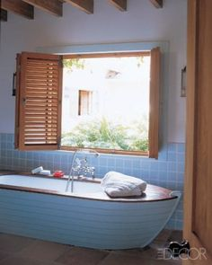 Shipshape ~ Colefax & Fowler decorator Philip Hooper constructed a whimsical rowboat-shaped teak-and-fiberglass tub surround for the children's bathroom in a family's Caribbean retreat.