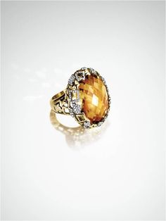 A very special gift: a Tapestry ring with diamonds and rich citrine.