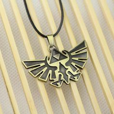 This Legend of Zelda triforce necklace is made of zinc alloy and comes with a polished bronze finish. Solid, durable and stylish, this necklace is a great gift for anyone who loves Legend of Zelda. Fi