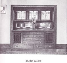 """Buffet with leaded glass published in millwork catalog in1921 by the Morgan Woodwork Organization and called """"Building with Assurance."""""""