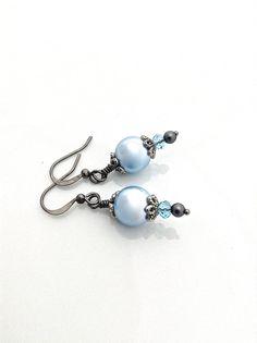 Sweet baby blue vegan crystal pearls by Swarovski paired with black gunmetal beadcaps and ear wire.  Cute for a goth wedding! #vegan #babyblue #gothwedding by #UrbanClink, $21.50