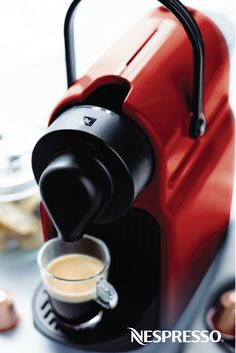 Nespresso -- Inissia coffee machine.  Compact in design, lightweight and with an handle.