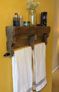 Repurposed pallet with curtain rod - towel rack with shelves.