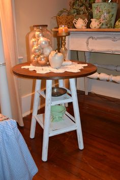 Tutorial for a rustic chic side table made from a bar stool base and a round table top.