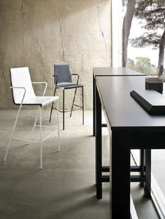 'Snake' by Gaber.  Stool in chromed or painted metal and techno polymer seat available in several colours.