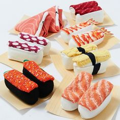 Fun to look at and fun to wear! These Sushi Socks look just like delicious sushi when rolled up. Your sock drawer will never be the same! They are also comfortable and durable. The sushi detail is knitted into the sock with colored thread instead of being printed. Seven versions are available: Masuzushi (trout sushi), Shrimp, Octopus, Red Caviar, Tuna, Salmon, and Egg. These Sushi Socks made in To...