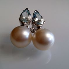 South Sea Pearls & Aquamarine Earrings. South Sea Pearls: 13.7mm (GIA certified). Aquamarines: 2.32cts. Mounted in 18K White gold.