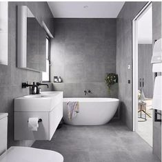 All grey tiles, white fixtures and fittings - modern
