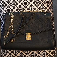 "Authentic Louis Vuitton Saint Germaine MM Shoulder bag black Empreinte.  12.6""length x 3.9""wide x 9.4""tall.  Largest size in this bag. Pre-loved with light scratches on front hardware (shown in pictures) excellent condition overall. Louis Vuitton Bags Shoulder Bags"