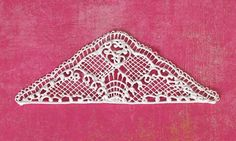 Lace filigree piece with latticework.