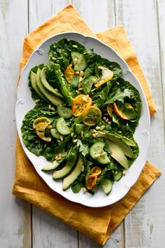 A vegetarian caramelized citrus and avocado salad recipe with fuerte avocadoes, mint, parsley and pinenuts.