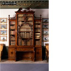 Thomas Chippendale`s Bookcase.  His huge bookcase. He used mahogani.  That was his favorite material.  The texture of wood and the symmetrical design provids grandiosity of space(room).