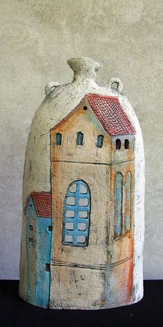 windowbottle -- it's a goal of mine to own something like this someday... perfectly useless and charming.